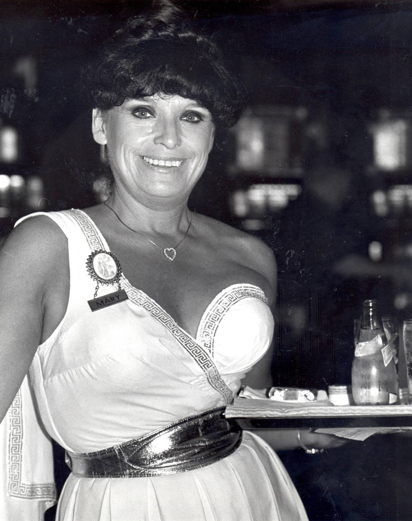 Mary Azzara, who has lived in the same apartment at The Palms apartments on Sahara Avenue for over 50 years, is shown in a 1982 Review-Journal file photo serving cocktails at Caesars Palace as an  ...