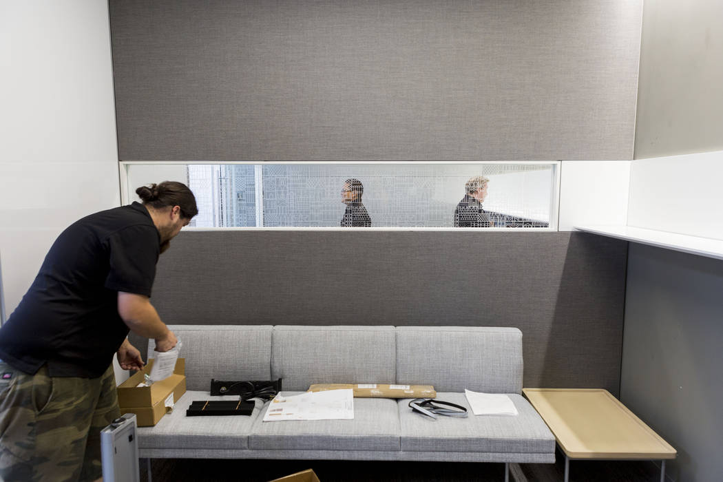 Installers place new shelves in the former Gamblerճ Book Shop near Charleston Boulevard and Maryland Parkway in Las Vegas, Thursday, July 27, 2017.  Henriksen/Butler, an office-furniture fir ...