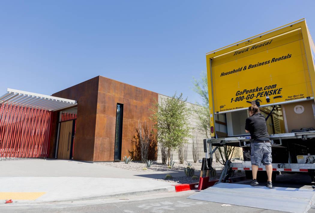Lead installer Brandon Camarena works on the former Gamblerճ Book Shop near Charleston Boulevard and Maryland Parkway  in Las Vegas, Thursday, July 27, 2017. Henriksen/Butler, an office-furn ...