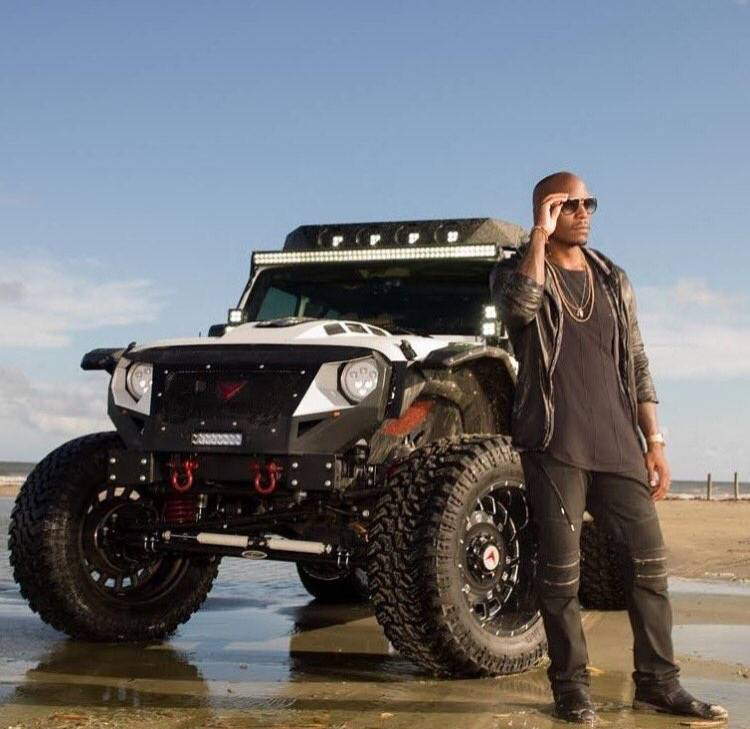 Tyrese Gibson in front of a Voltron Motors Rebel Jeep. (Courtesy)