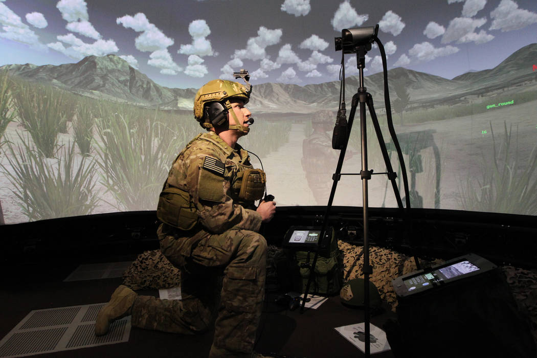 U.S. Air Force Joint Terminal Attack Controller instructor Capt. Ray Reeves demonstrates how to train using an Advanced Air National Guard JTAC Training Simulator at Nellis Air Force Base in Las V ...
