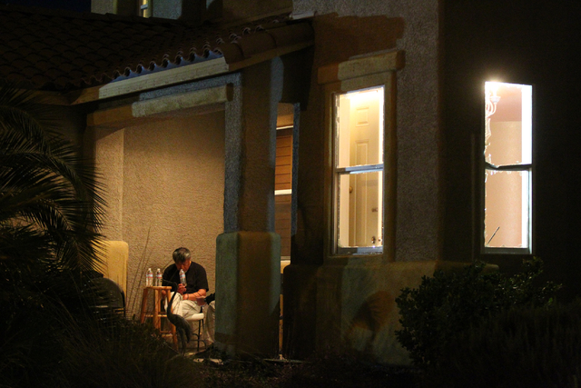 Las Vegas police serve a search warrant on a home on the 9600 block of Grouse Grove Avenue near Sunset Road and Grand Canyon Drive in Las Vegas on Friday, Feb. 20, 2015. (Chase Stevens/Las Vegas R ...