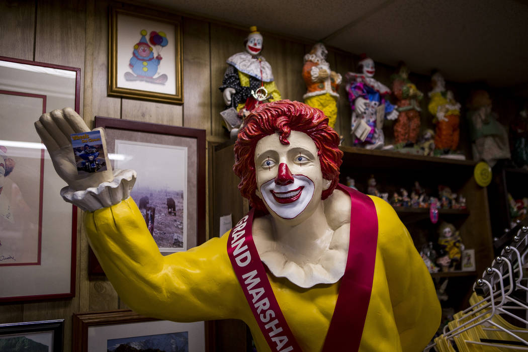 A Ronald McDonald statue joins about 600 other clowns in the lobby of the Clown Motel in Tonopah on Tuesday, July 25, 2017. The Clown is currently for sale with the condition that the new owner mu ...