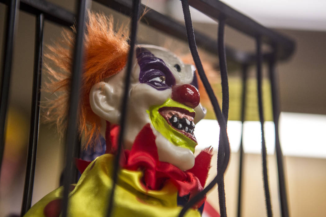 A creepy clown locked up in a cage in the lobby of the Clown Motel in Tonopah on Tuesday, July 25, 2017. The Clown is currently for sale with the condition that the new owner must keep the clown t ...