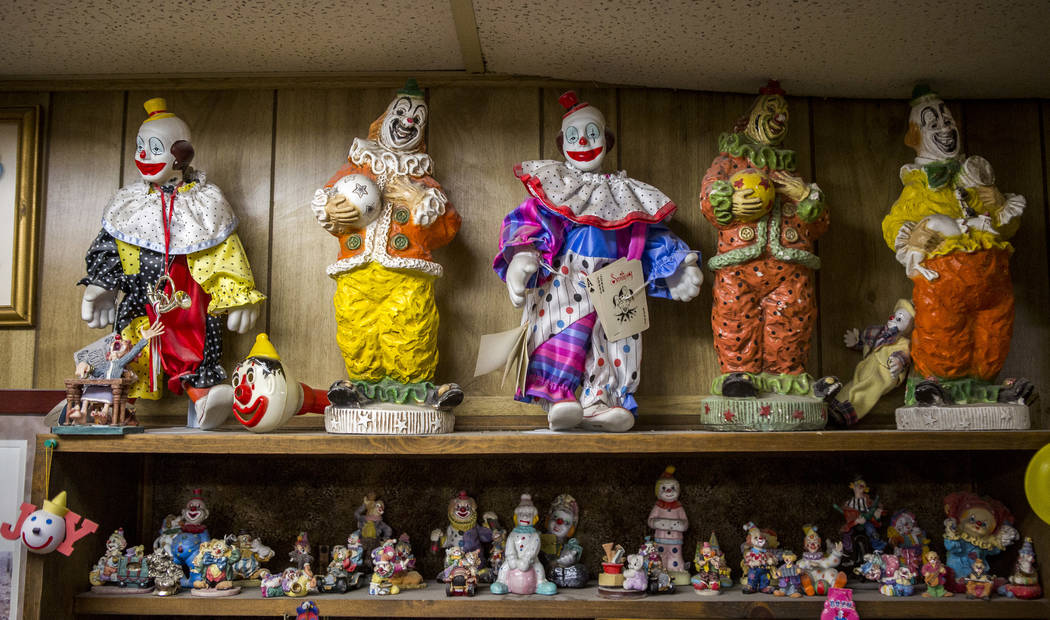 About 600 clowns crowd into the lobby of the Clown Motel in Tonopah on Tuesday, July 25, 2017. The Clown is currently for sale with the condition that the new owner must keep the clown theme.  Pat ...