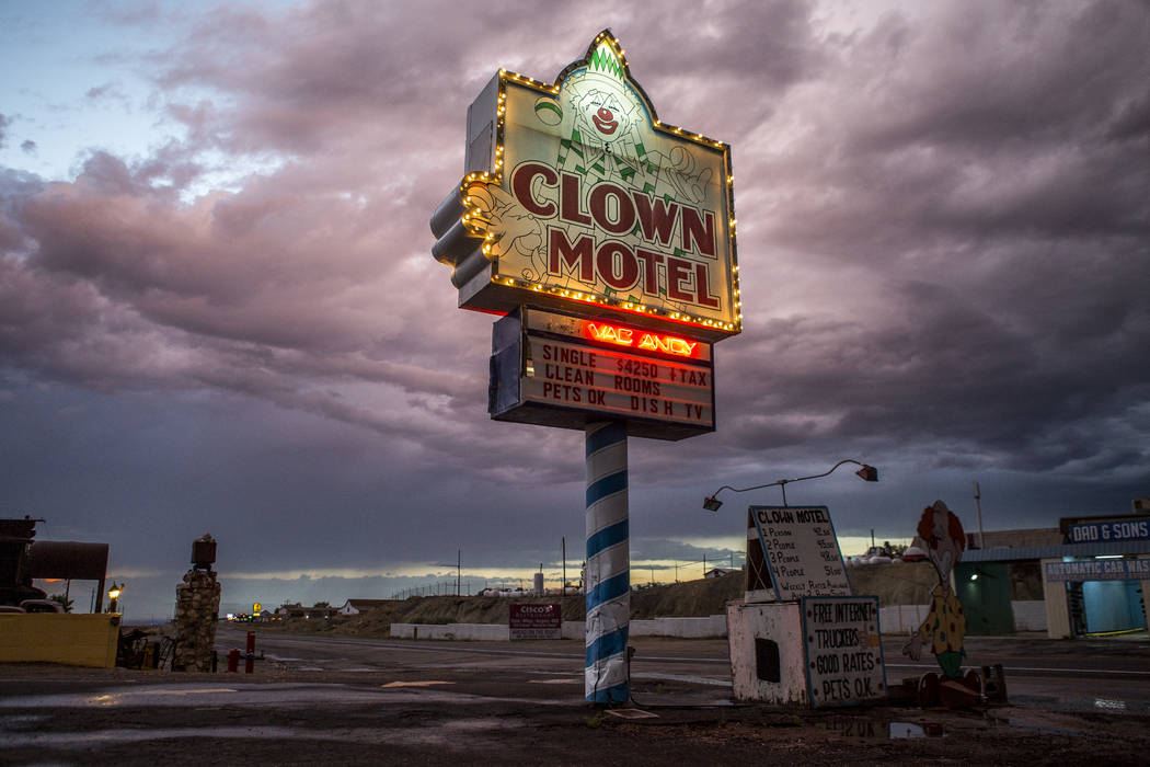 The Clown Motel sign glows as the sun sets along Main Street in Tonopah on Tuesday, July 25, 2017. The Clown is currently for sale with the condition that the new owner must keep the clown theme.  ...