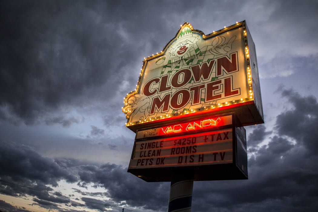The Clown Motel sign glows as the sun sets in Tonopah on Tuesday, July 25, 2017. The Clown is currently for sale with the condition that the new owner must keep the clown theme.  Patrick Connolly  ...