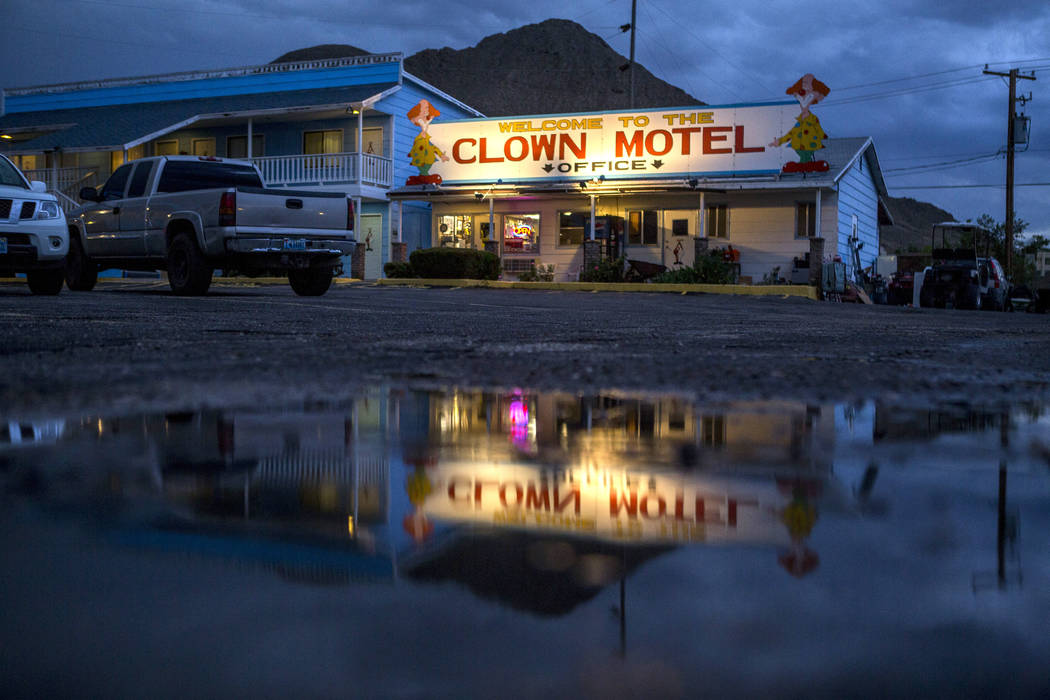 The office of the Clown Motel is reflected in a puddle at dusk in Tonopah on Tuesday, July 25, 2017. The Clown is currently for sale with the condition that the new owner must keep the clown theme ...