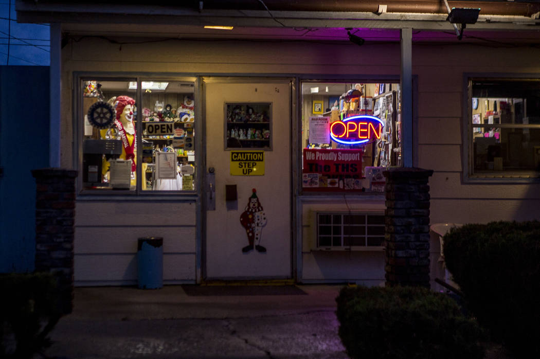 Warm lights glow at dusk outside of the Clown Motel office in Tonopah on Tuesday, July 25, 2017. The Clown is currently for sale with the condition that the new owner must keep the clown theme.  P ...