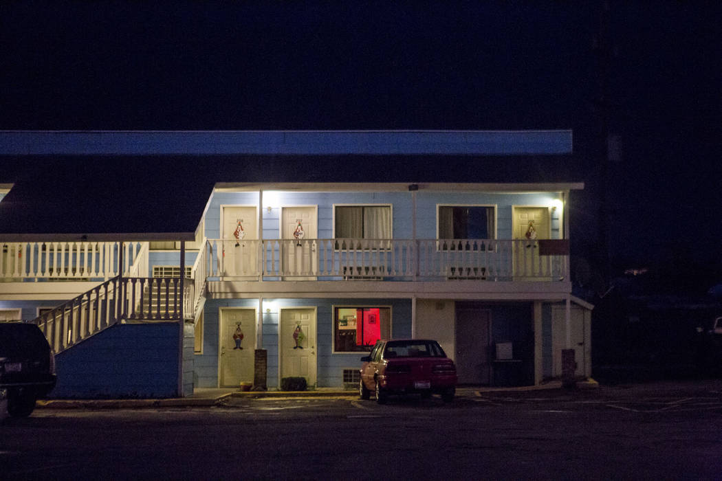Warm lights illuminate walkways at the Clown Motel in Tonopah on Tuesday, July 25, 2017. The Clown is currently for sale with the condition that the new owner must keep the clown theme.  Patrick C ...