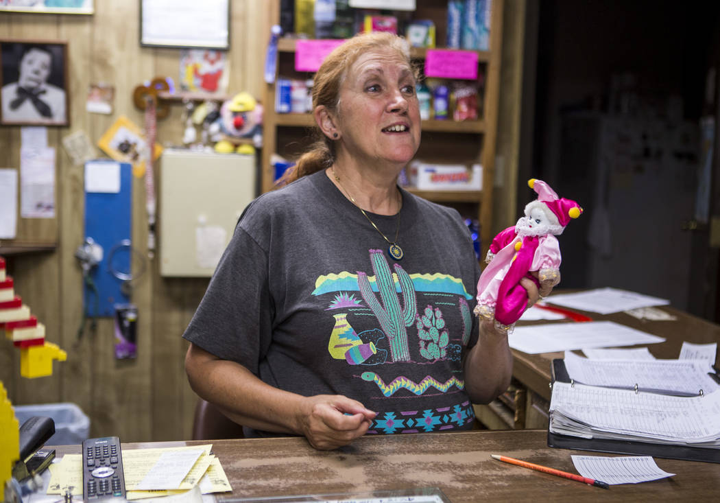 Marlena Dufour accepts a new clown donation at the Clown Motel in Tonopah on Tuesday, July 25, 2017. Visitors have traveled from around the world to stay at the motel, and many have brought clown  ...