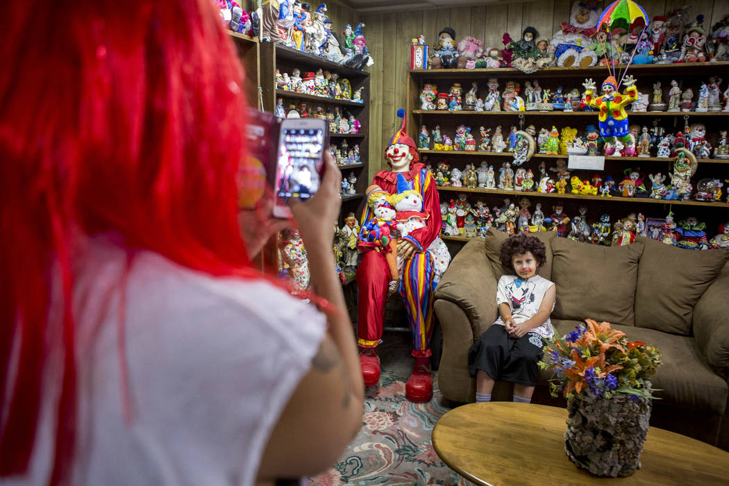 Penny James takes a photo of her son Kai, 9, in the lobby of the Clown Motel in Tonopah on Tuesday, July 25, 2017. The Las Vegas residents came to stay for a night and dressed up in clown attire.  ...