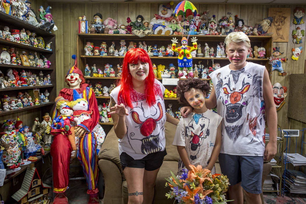 Penny James with her sons Kai, 9, and Caden, 15, in the lobby of the Clown Motel in Tonopah on Tuesday, July 25, 2017. The Las Vegas residents came to stay for a night and dressed up in clown atti ...