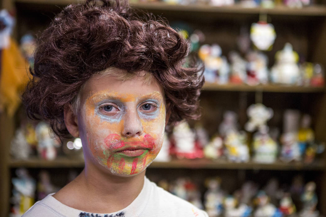 Kai James, 9, in the lobby of the Clown Motel in Tonopah on Tuesday, July 25, 2017. James came with his brother and mother from Las Vegas to stay for a night and dressed up in clown attire.  Patri ...