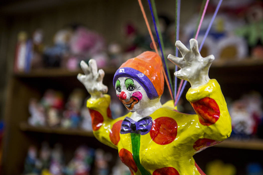 A clown hangs from a parachute along with about 600 other clowns in the lobby of the Clown Motel in Tonopah on Tuesday, July 25, 2017. The Clown is currently for sale with the condition that the n ...