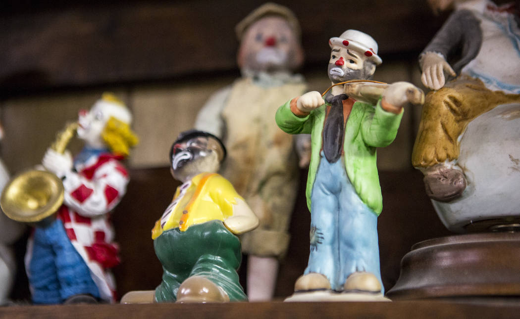 A sad clown plays the violin along with about 600 other clowns in the lobby of the Clown Motel in Tonopah on Tuesday, July 25, 2017. Visitors have traveled from around the world to stay at the mot ...