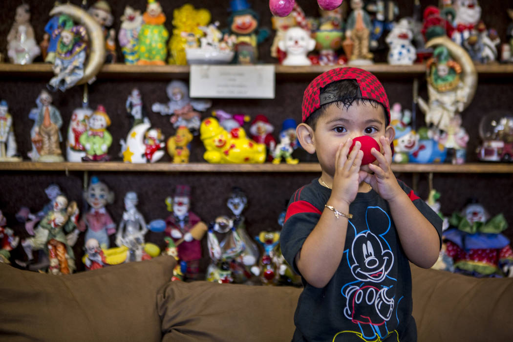 Sky Duran, 2, the son of a motel guest, tries on a clown nose in the lobby of the Clown Motel in Tonopah on Wednesday, July 26, 2017. The Clown is currently for sale with the condition that the ne ...