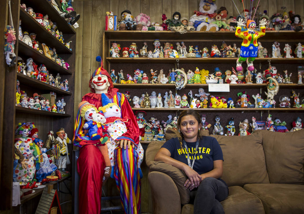 Lisbi Bravo, a housekeeper, sits among about 600 clowns in the lobby of the Clown Motel in Tonopah on Wednesday, July 26, 2017. Bravo has worked at the Clown Motel for four months and began experi ...