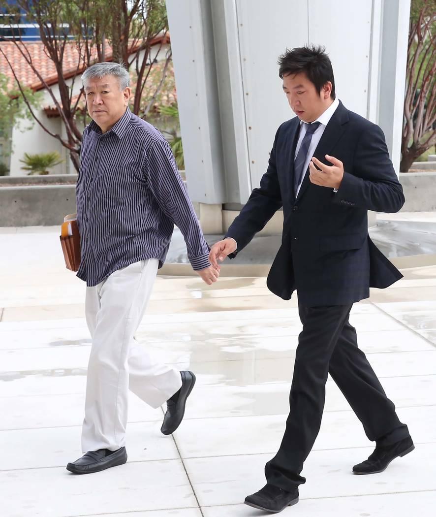 Jianguo Han, left, and his son Bing, accused of growing hundreds of marijuana plants, arrive at the Lloyd George U.S. Courthouse on Tuesday, July 25, 2017, in Las Vegas. Bizuayehu Tesfaye Las Vega ...