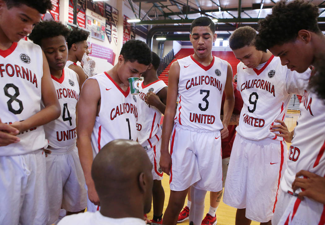 California United players gather around their coach and NBA player Quincy Pondexter during an AAU game at Liberty High School on Friday, July 28, 2017 in Henderson. Bridget Bennett Las Vegas Revie ...