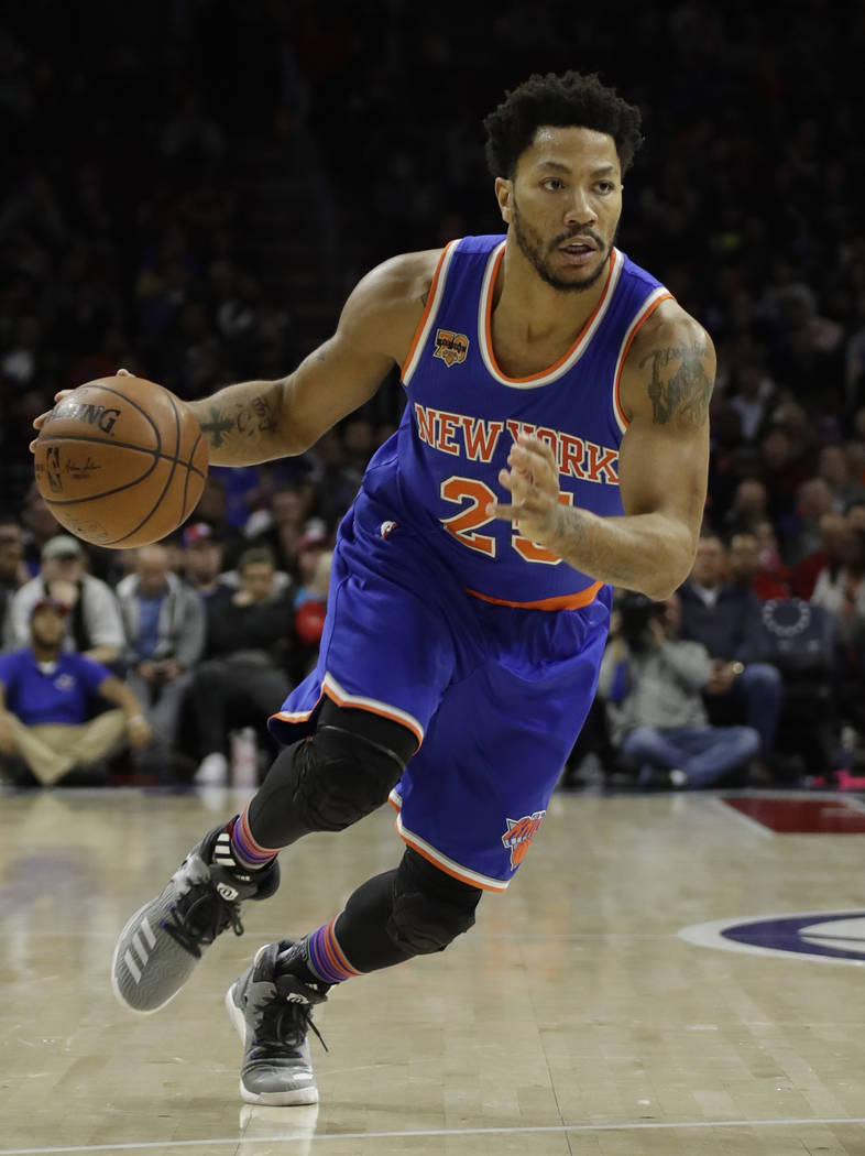 In this March 3, 2017, file photo, New York Knicks' Derrick Rose drives down court during an NBA basketball game against the Philadelphia 76ers, in Philadelphia.  Two people familiar with the nego ...