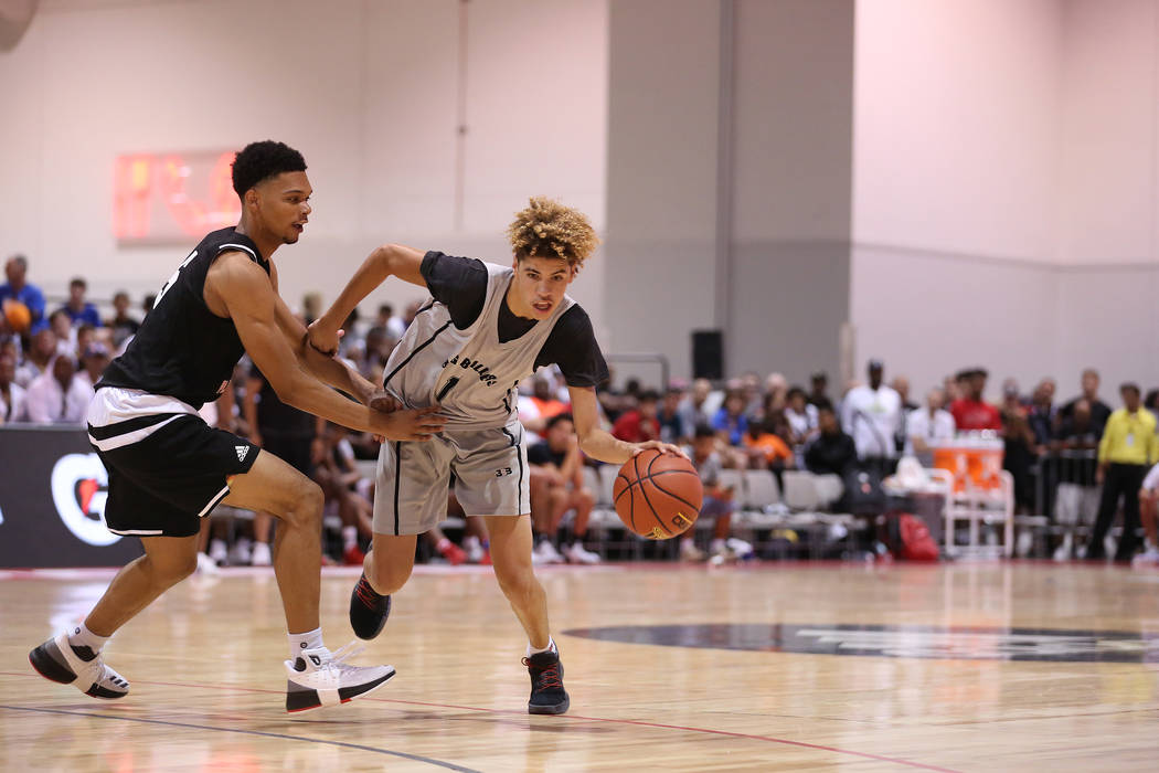 Big Baller Brand player LaMelo Ball tries to drive past a Play Hard Play Smart player during an Adidas Summer Championship AAU tournament game at Cashman Center in Las Vegas on Thursday, July 27,  ...