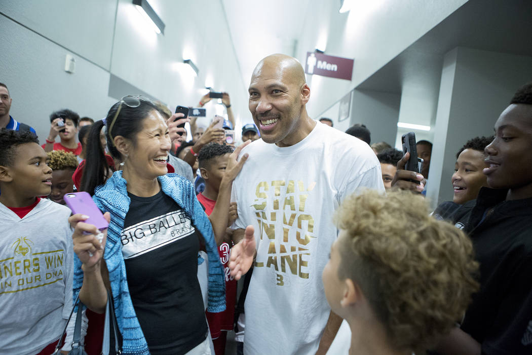 Fans swarm Big Baller Brand AAU team coach LaVar Ball after an Adidas Summer Championship AAU tournament game at Cashman Center in Las Vegas on Thursday, July 27, 2017.  Bridget Bennett Las Vegas  ...