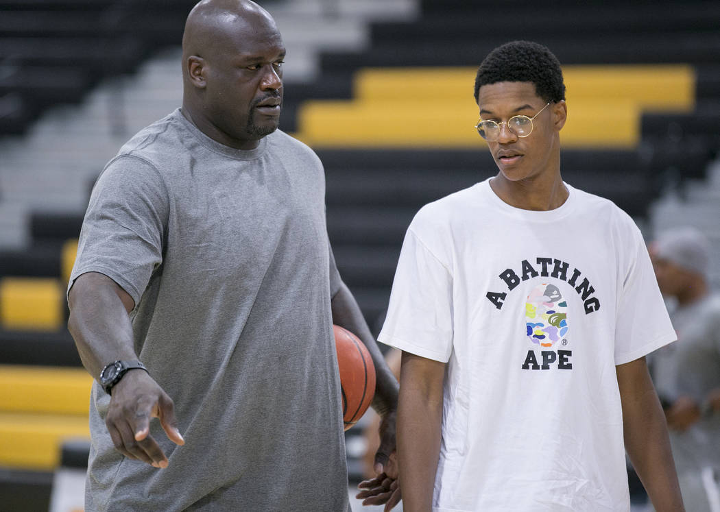 Cal Supreme player Shareef O'Neal, right is coached by his dad Shaquille O'Neal, left, during a team practice at Ed W. Clark High School in Las Vegas on Wednesday, July 26, 2017.  Bridget Bennett  ...