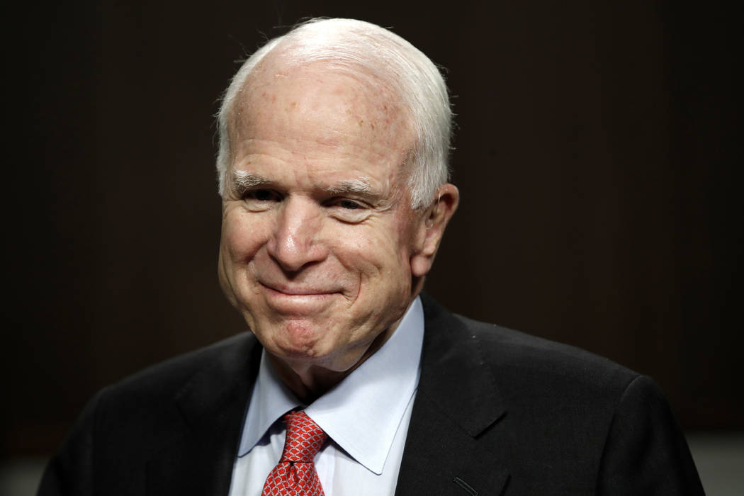 FILE - In this July 11, 2017, file photo, Sen. John McCain, R-Ariz., arrives on Capitol Hill in Washington. McCain has been diagnosed with a brain tumor after a blood clot was removed. (AP Photo/J ...