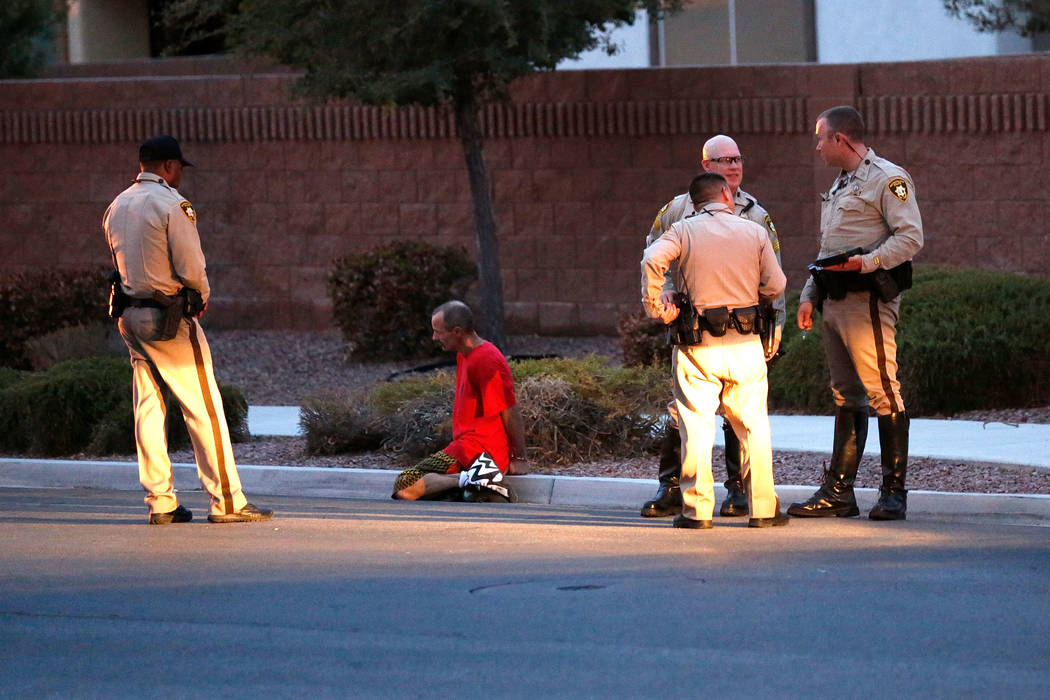 Police officers investigate an officer-involved shooting on North Goldfield Street in North Las Vegas, Monday, July 24, 2017. According to police, two people have been shot and taken to local hosp ...
