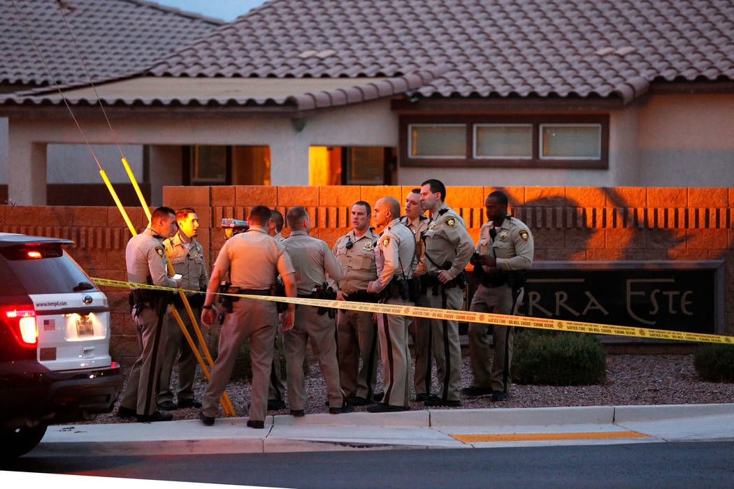 Police officers investigate an officer-involved shooting on North Goldfield Street in North Las Vegas, Monday, July 24, 2017. According to police, two people were shot and taken to local hospitals ...