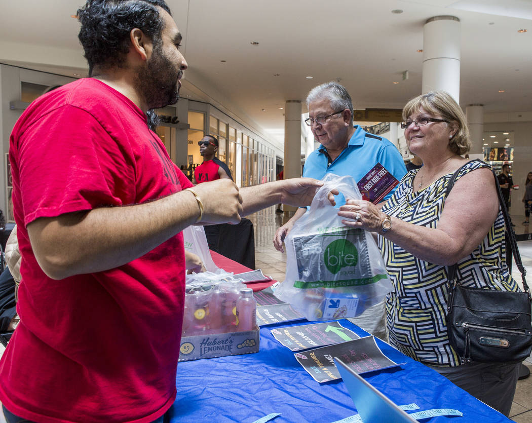 Angel Escamilla, a partner with Live to Give, hands out school supplies to teachers during a Supply a Teacher event at the Galleria at Sunset Mall in Henderson on Saturday, July 29, 2017. Escamill ...
