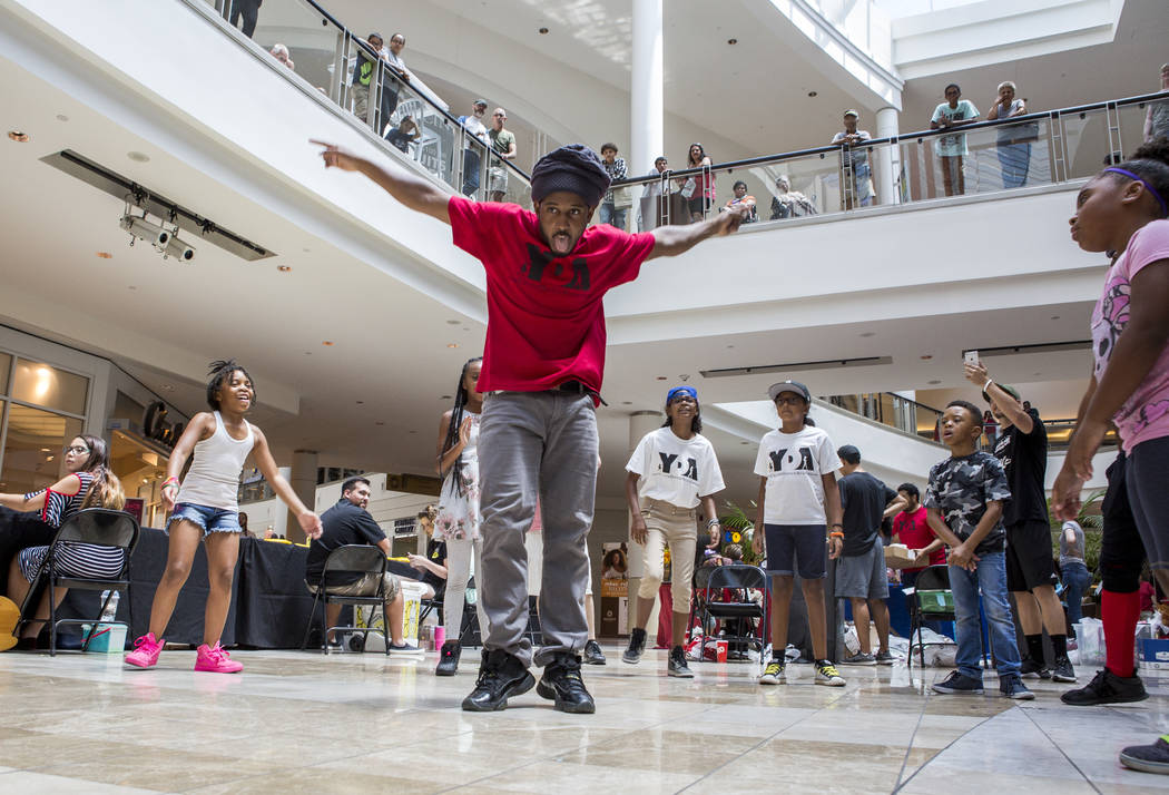 Joseph Smith, an instructor with Youth Dance Academy, shows off his moves in a dance circle during a Supply a Teacher event at the Galleria at Sunset Mall in Henderson on Saturday, July 29, 2017.  ...