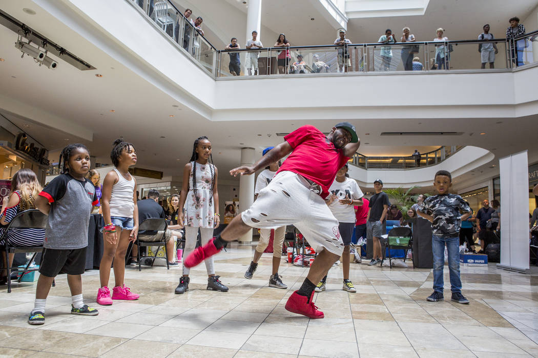 Dhon Blackwell, an instructor with Youth Dance Academy, shows off his moves in a dance circle during a Supply a Teacher event at the Galleria at Sunset Mall in Henderson on Saturday, July 29, 2017 ...