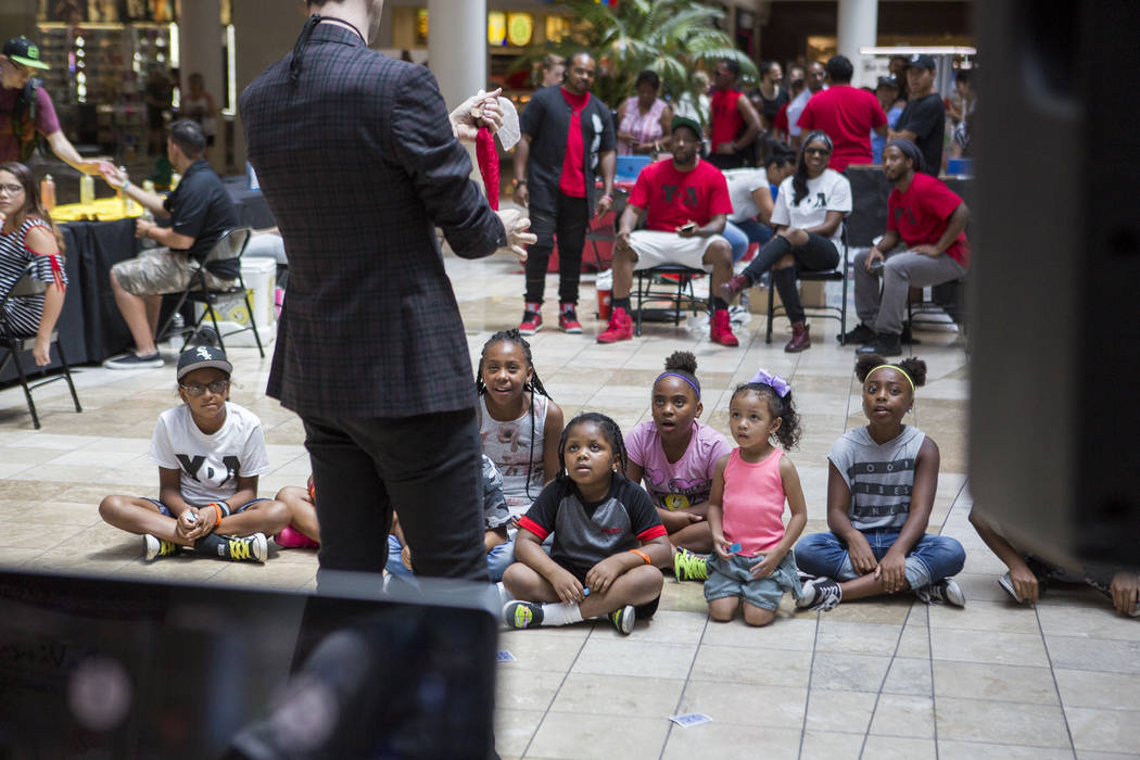 Children watch intently as magician Jason Andrews performs during a Supply a Teacher event at the Galleria at Sunset Mall in Henderson on Saturday, July 29, 2017.  Patrick Connolly Las Vegas Revie ...