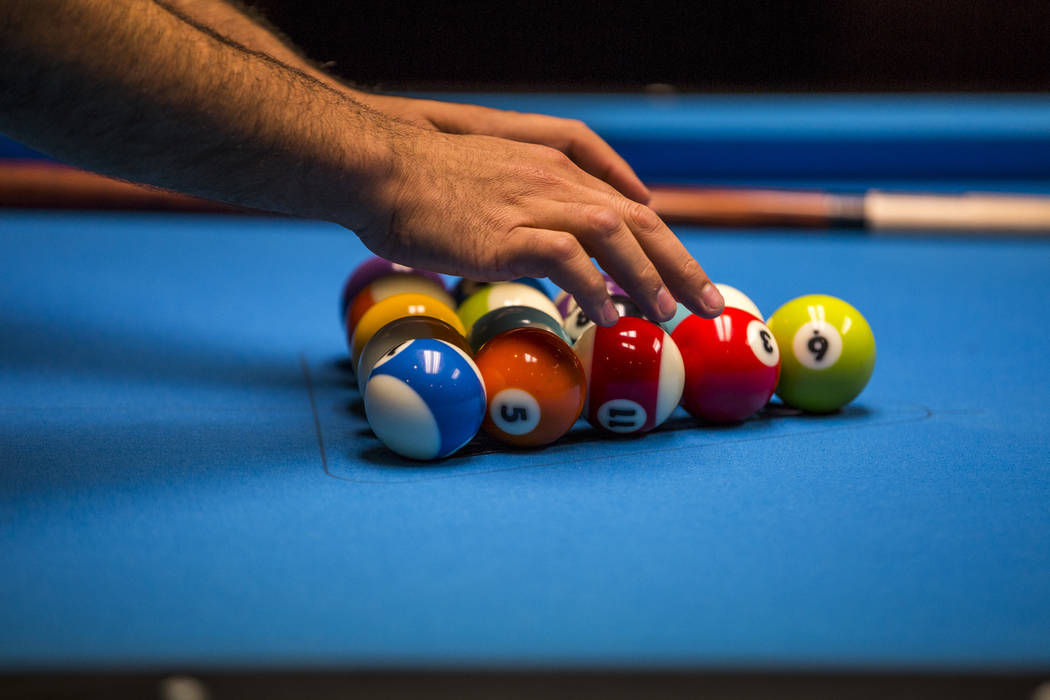 A pool player racks up balls while practicing during the U.S. Open 8-Ball Championship at Griff's Las Vegas on Sunday, July 30, 2017.  Patrick Connolly Las Vegas Review-Journal @PConnPie
