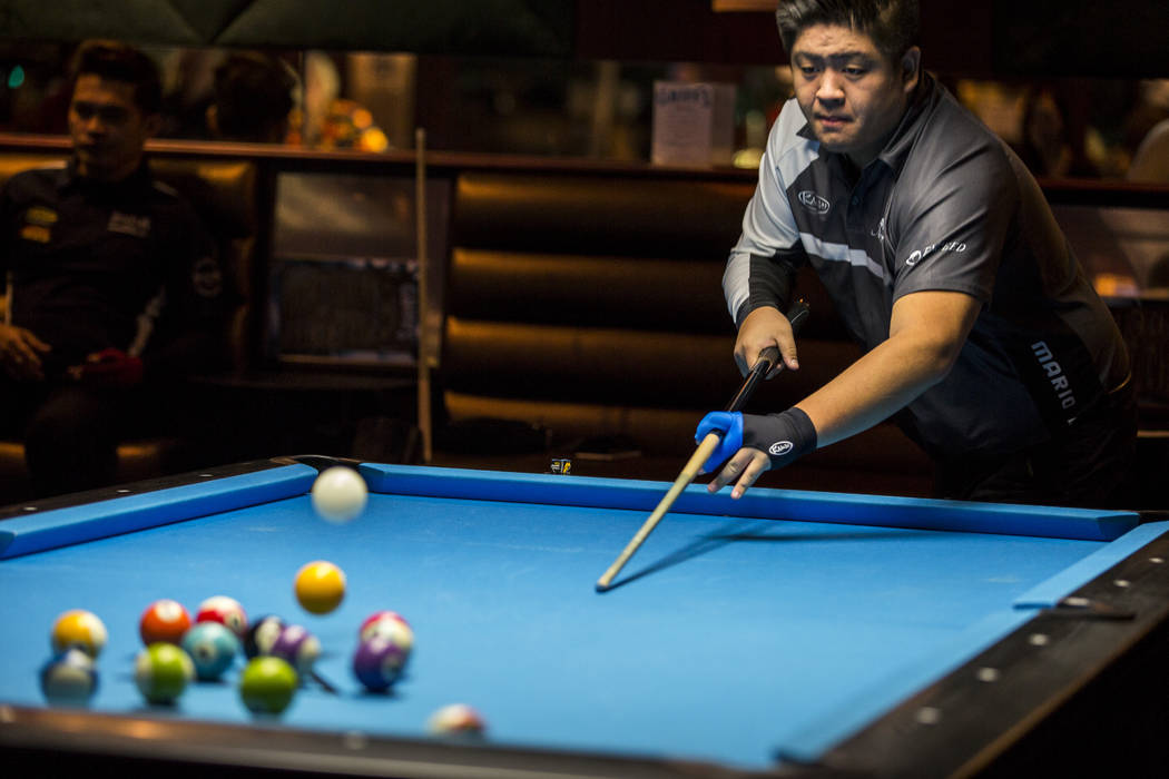 Mario He breaks at the beginning of a match during the U.S. Open 8-Ball Championship at Griff's Las Vegas on Sunday, July 30, 2017.  Patrick Connolly Las Vegas Review-Journal @PConnPie