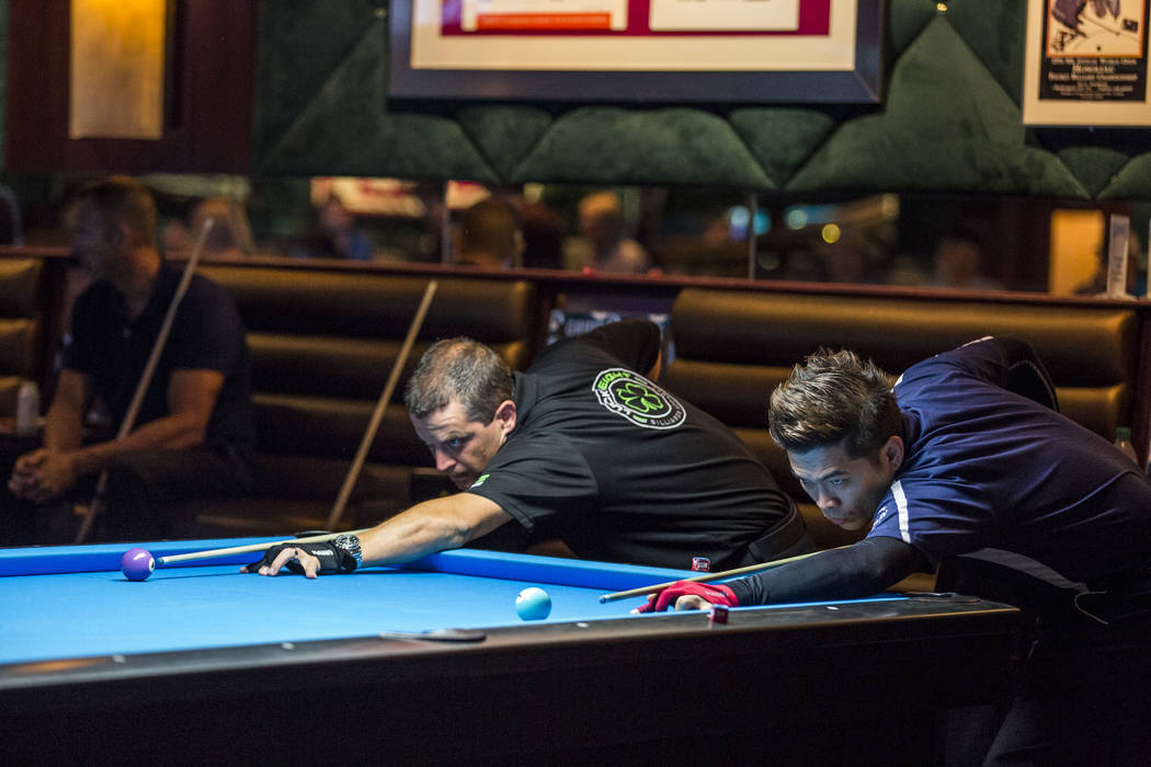 Roberto Gomez Jr., right,  and Chris McDaniel see who will get to break during the U.S. Open 8-Ball Championship at Griff's Las Vegas on Sunday, July 30, 2017.  Patrick Connolly Las Vegas Review-J ...