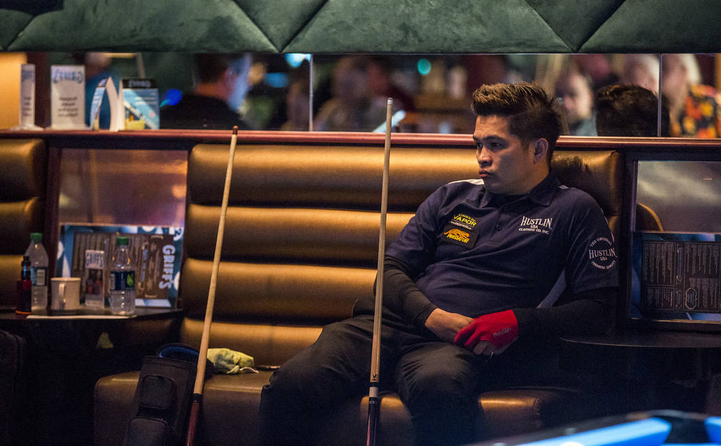Roberto Gomez Jr. watches as his opponent takes his turn during the U.S. Open 8-Ball Championship at Griff's Las Vegas on Sunday, July 30, 2017.  Patrick Connolly Las Vegas Review-Journal @PConnPie