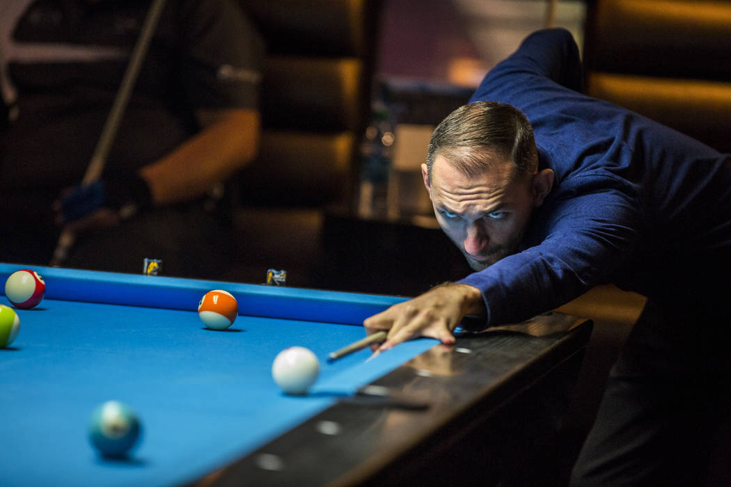 Vilmos Foldes lines up his shot during the U.S. Open 8-Ball Championship at Griff's Las Vegas on Sunday, July 30, 2017.  Patrick Connolly Las Vegas Review-Journal @PConnPie