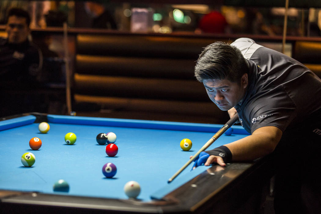 Mario He lines up his shot during the U.S. Open 8-Ball Championship at Griff's Las Vegas on Sunday, July 30, 2017.  Patrick Connolly Las Vegas Review-Journal @PConnPie