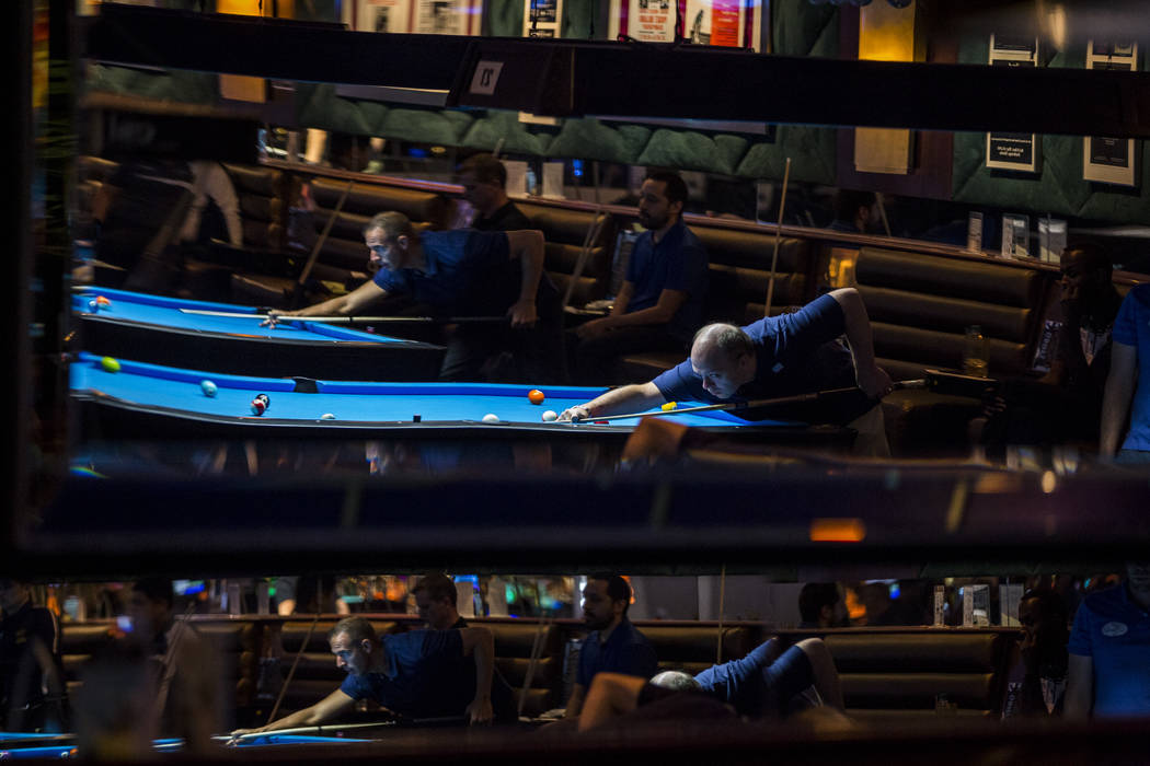 Pool players are reflected in a mirror during the U.S. Open 8-Ball Championship at Griff's Las Vegas on Sunday, July 30, 2017.  Patrick Connolly Las Vegas Review-Journal @PConnPie