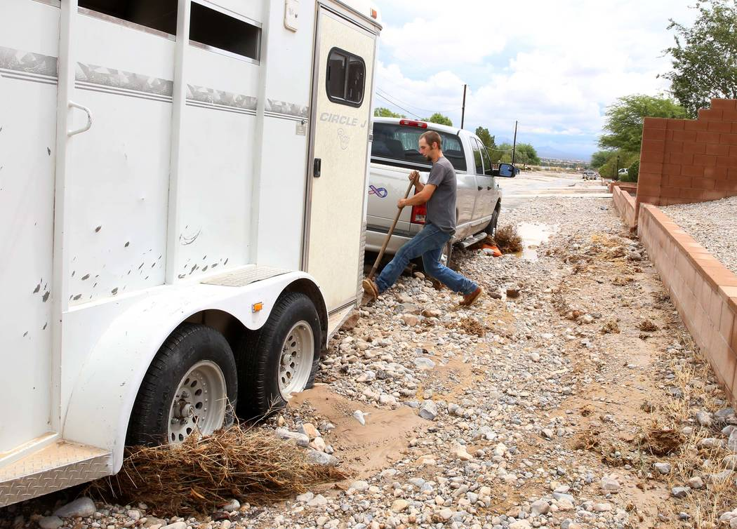 Clinton Jacob tries to free his truck and horse trailer from flood debris outside his home on Brent Lane on Tuesday, July 25, 2017, in Las Vegas. Bizuayehu Tesfaye Las Vegas Review-Journal @bizute ...