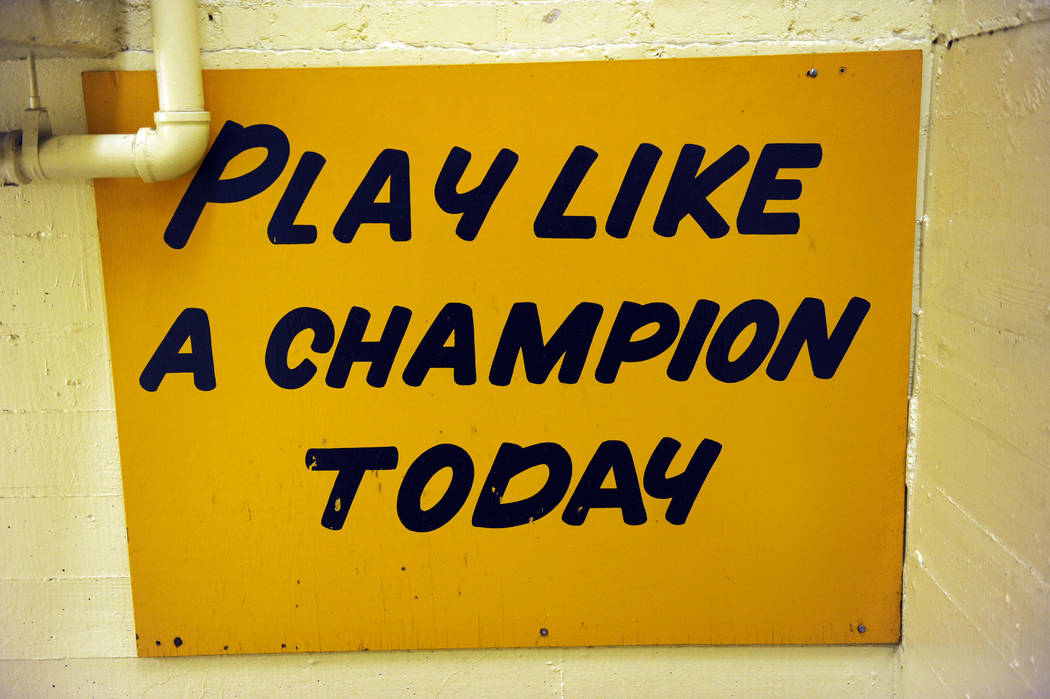 """The hallway between the locker room and the field at Notre Dame stadium features a sign """"Play like a Champion Today"""" displayed Monday Nov. 21, 2011. Notre Dame football players o ..."""