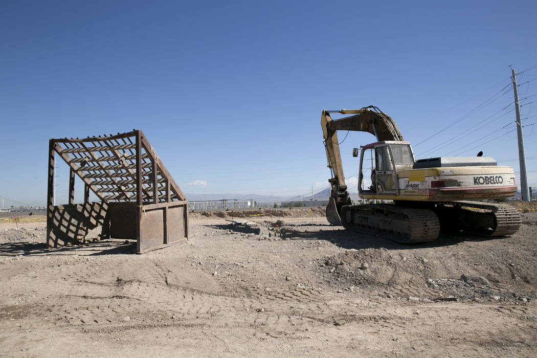 An excavator sits at the future site of an Arco gas station and an AM-PM mini-mart near the intersection of North Gibson Road and Wigwam Parkway in Henderson, Friday, July 28, 2017. Nevada State B ...