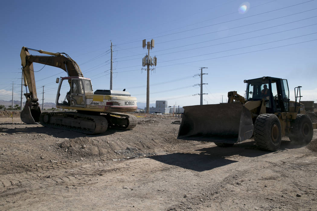 A construction worker drives a bulldozer on the future site of an Arco gas station and an AM-PM mini-mart near the intersection of North Gibson Road and Wigwam Parkway in Henderson, Friday, July 2 ...