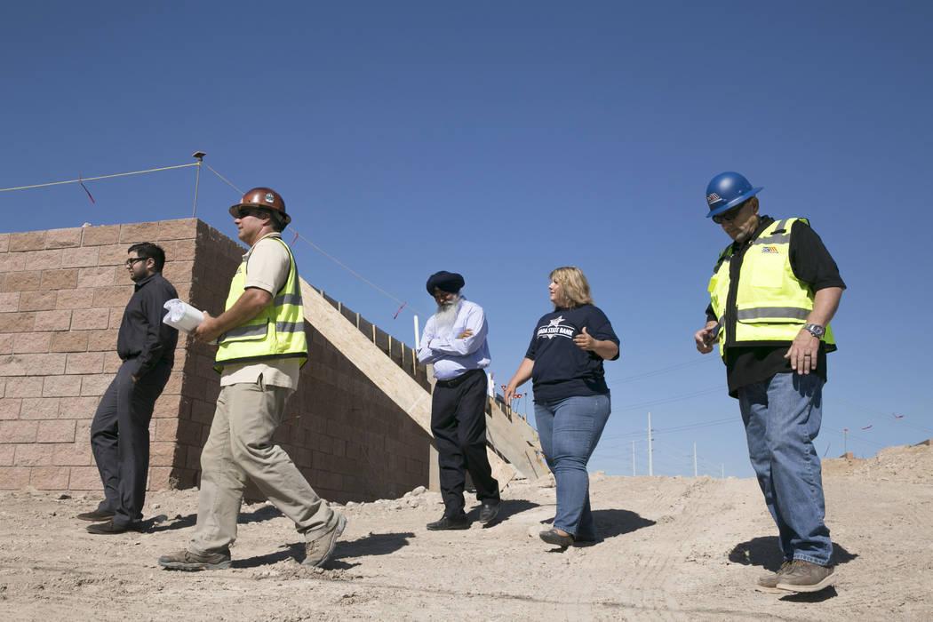 Akashi Bhatti (left), Construction Superintendent Mike Stephenson (left center), Bill Bhatti (center), Sherri Weaver (center right) of the Nevada State Bank and Construction Superintendent Bruce K ...
