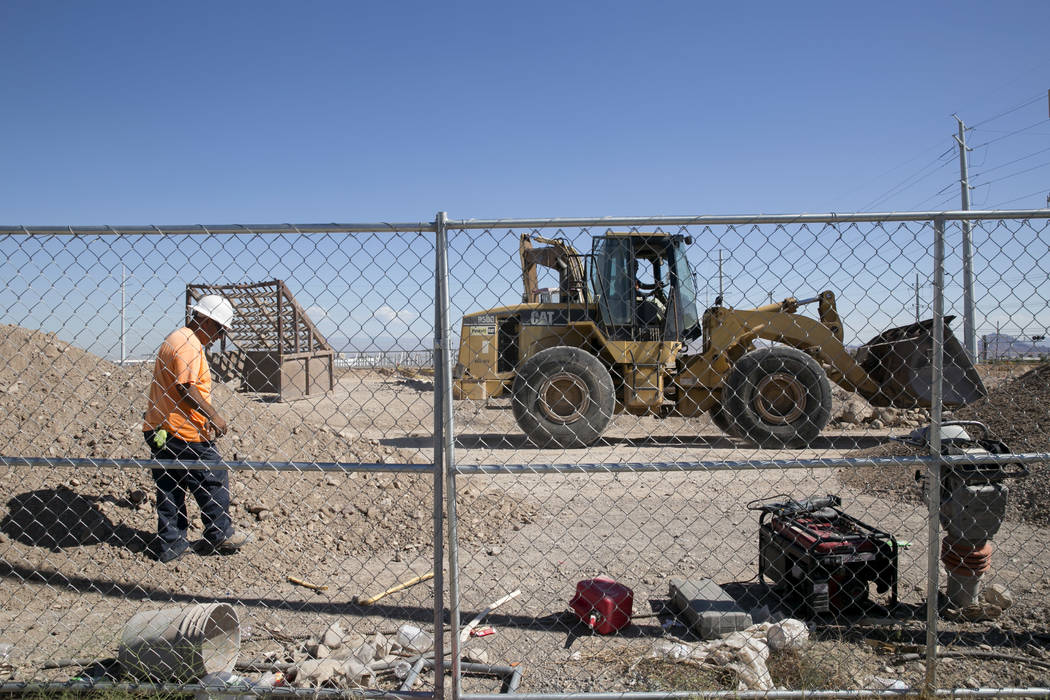 Construction workers work at the future site of an Arco gas station and an AM-PM mini-mart near the intersection of North Gibson Road and Wigwam Parkway in Henderson, Friday, July 28, 2017. Nevada ...