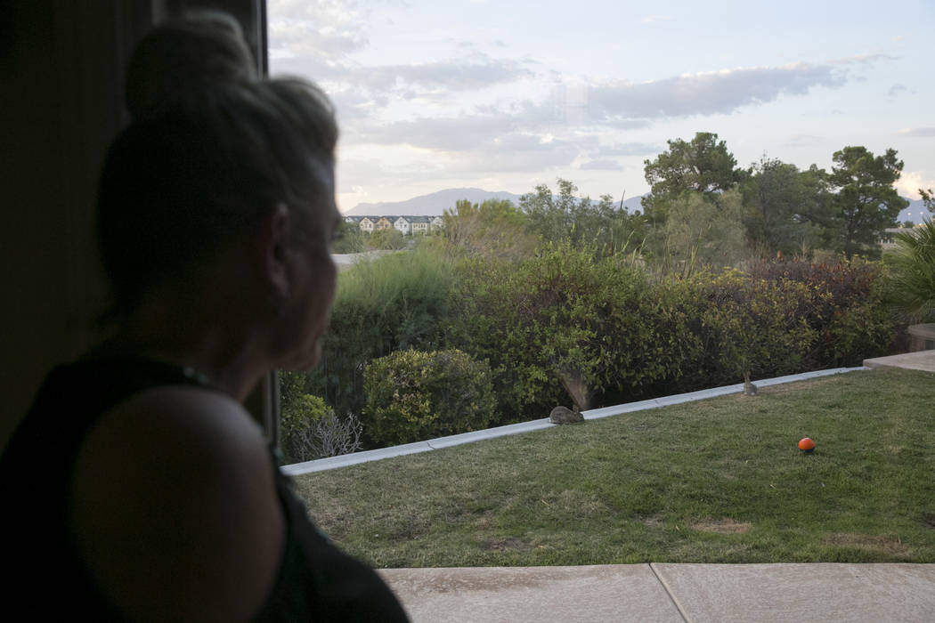 Eva Thomas watches a wild rabbit graze in her backyard in Queensridge, Las Vegas, Thursday, July 27, 2017. In June 2017, the Badlands Golf Course's owners turned the water off, allowing the grass  ...