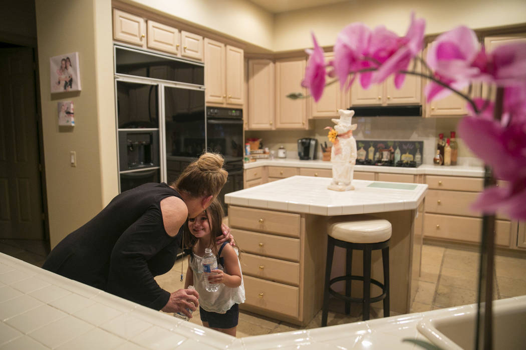 Eva Thomas, left,  plants a kiss on her granddaughter, Zoey Nino's head at Thomas' home in Queensridge, Las Vegas, Thursday, July 27, 2017. In June 2017, the Badlands Golf Course's owners turned t ...